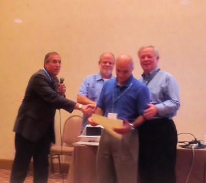 Dr. Carlson receiving the Best Paper award