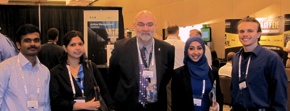 Adjunct Industry Professor of ITM Bill Slater (center) and ITM students Girithar Anthay Suthakavan, Shikha Srivastava, Samah Sallam and Adem Maksuti (left to right), at the 2013 Data Center Dynamics Conference.