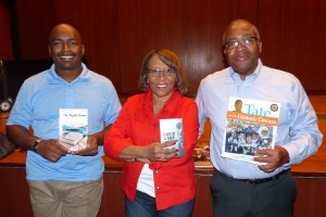 National Award Winning Author Sharon Draper (center) is pictured with Acclaimed Authors Earl Sewell and Bernard Turner. They each are holding copies of one of their books.